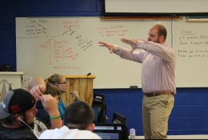 Coach Owen explains a task to the class.
