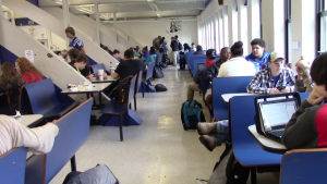Students enjoy lunch in the cafeteria.