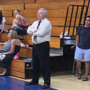 Mr. Credle watching the volleyball team celebrate their big win over East Henderson