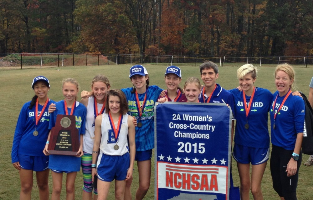 The 2015 BHS Women's Cross Country team at State with their trophy.