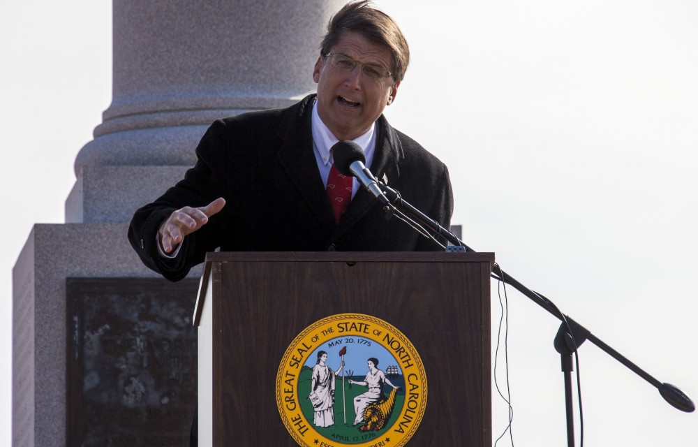 North Carolina Governor Pat McCrory speaks to visitors at the opening ceremony of the 150th Anniversary of the Battle of Fort Fisher commemoration at Kure Beach, N.C., Jan. 17, 2015. The Marine Corps Historical Interpretive Team, composed of members of the Marine Corps Historical Company and Single Marine Program Marines, used battle walks, historical weapons demonstrations and extensive exhibits to tell the story of Civil War Marines, showing the relevance and impact of the battle and its participants on today's Corps. (U.S. Marine Corps photo by Sgt. Christopher Q. Stone, MCI-East Combat Camera/Released)